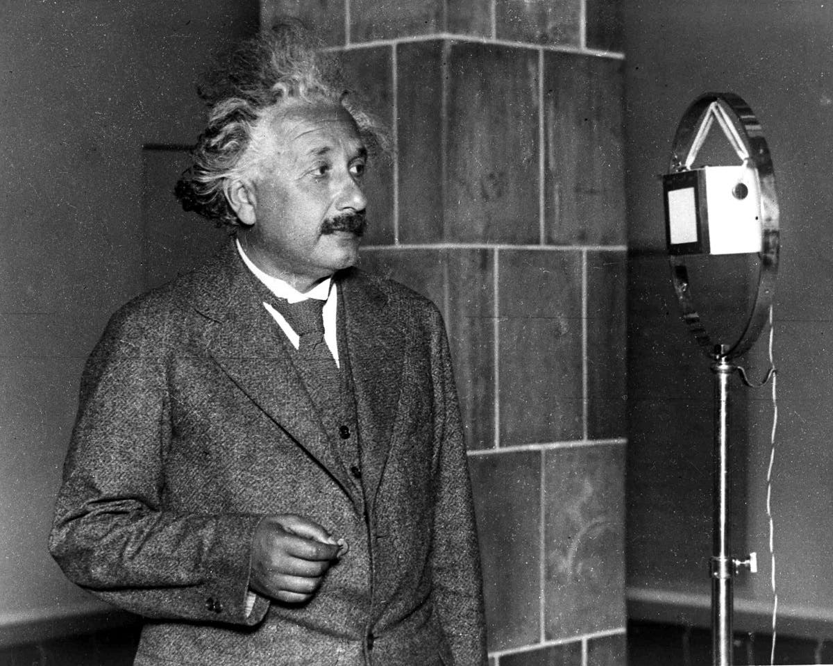 Professor Albert Einstein at the microphone, congratulates Thomas Edison on the 50 years anniversary of the first electric lamp, by telephone from Berlin to America, on Oct. 18, 1930. (AP )