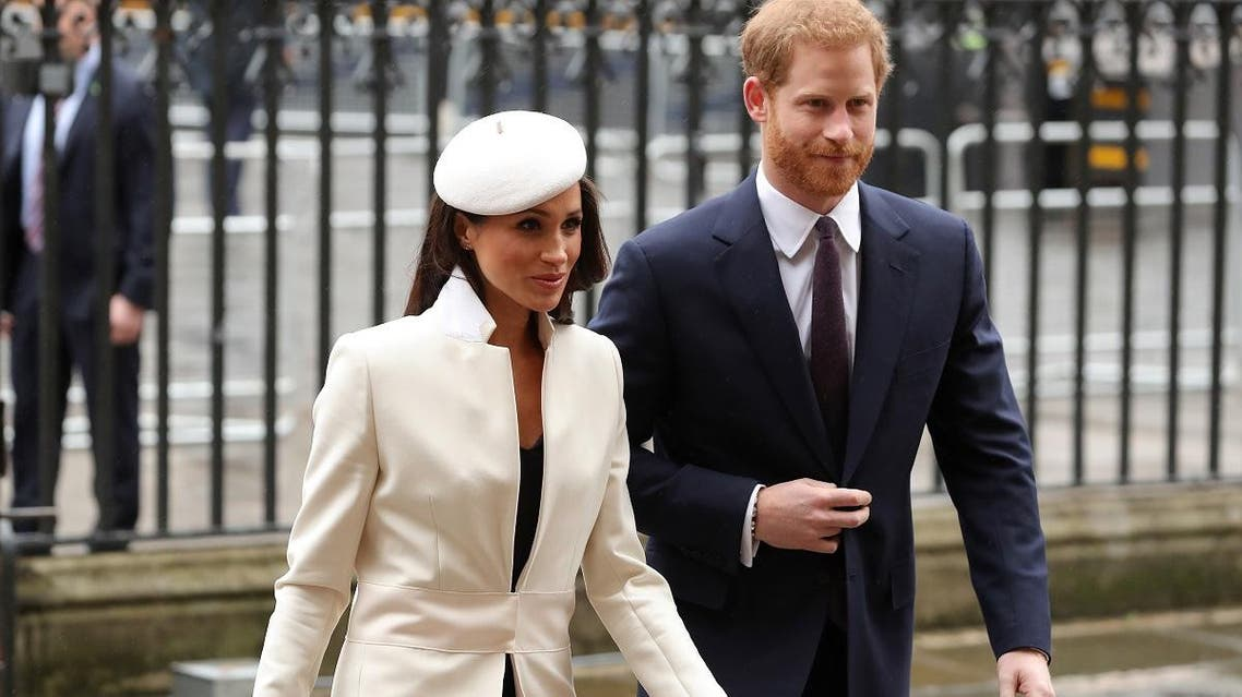 Britain's Prince Harry (R) and his fiancee US actress Meghan Markle attend a Commonwealth Day Service at Westminster Abbey in central London, on March 12, 2018. (AFP)