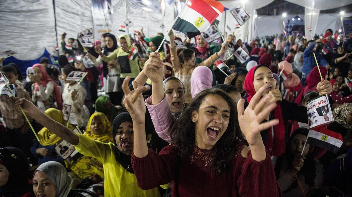 Egyptian supporters of President Abdel Fattah al-Sisi attend a rally in a neighbourhood in Cairo on March 9, 2018. (AFP)