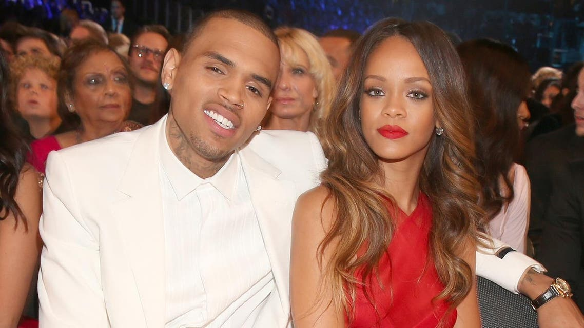 ingers Chris Brown (L) and Rihanna attend the 55th Annual GRAMMY Awards at STAPLES Center on February 10, 2013. (AFP)