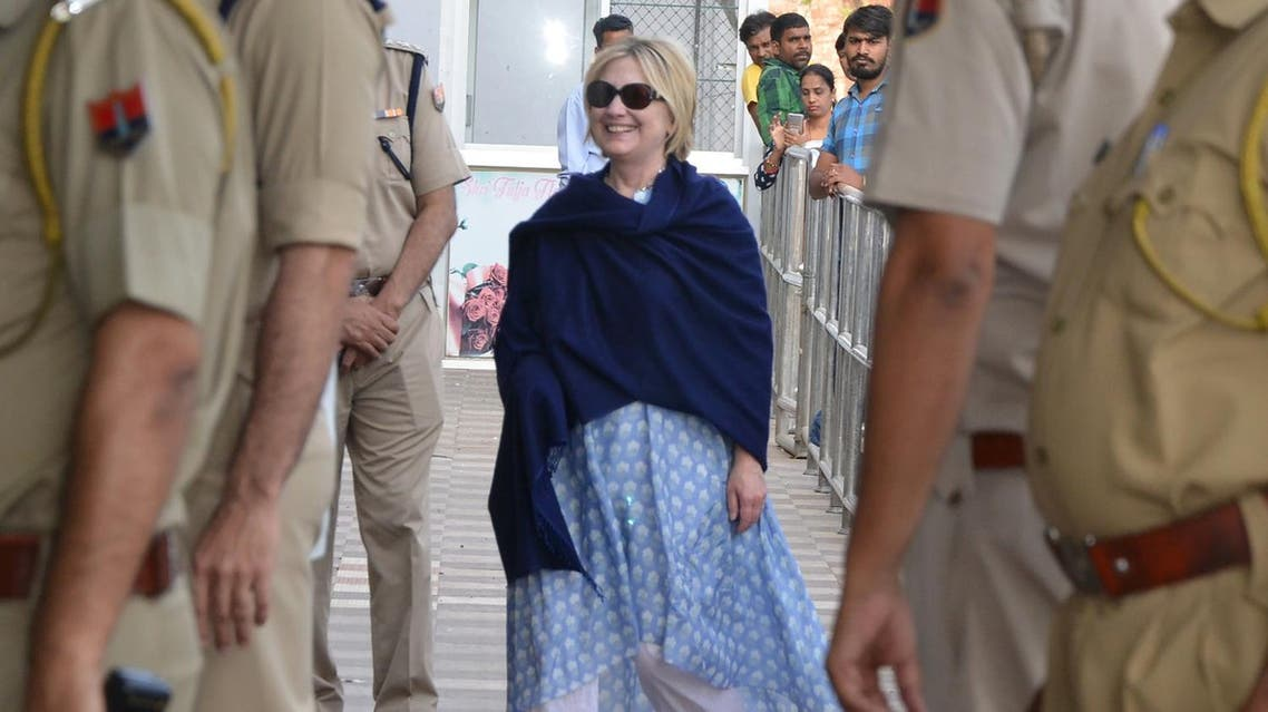 This photo taken on March 15, 2018 shows former US secretary of state Hillary Clinton, with her right hand covered under a shawl, at the airport as she leaves Jodhpur in the western Indian state of Rajasthan. (AFP)