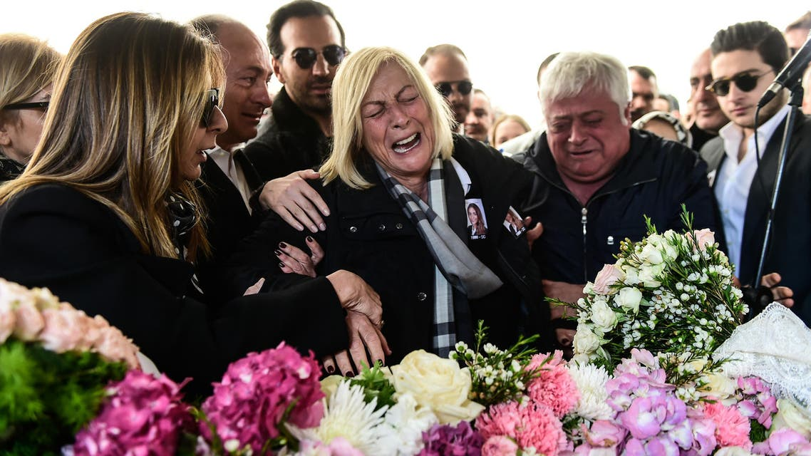 The aunt (C) and father (2ndR) of Mina Basaran one of the victims of a a plane crash over Iran mourn next to her coffin on March 15, 2018 during her funeral cerenomy in Istanbul. Grieving families bade farewell to the young women killed in a plane crash over Iran while returning from a pre-wedding celebration for a Turkish businessman's daughter, in a tragedy that shocked the country. (AFP) Better headline
