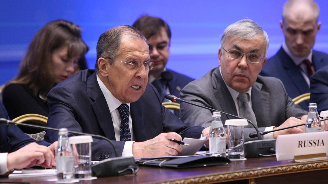 Russian Foreign Minister Sergei Lavrov (L) speaks during the international meeting on Syria in Astana, Kazakhstan March 16, 2018. REUTERS/Mukhtar Kholdorbekov