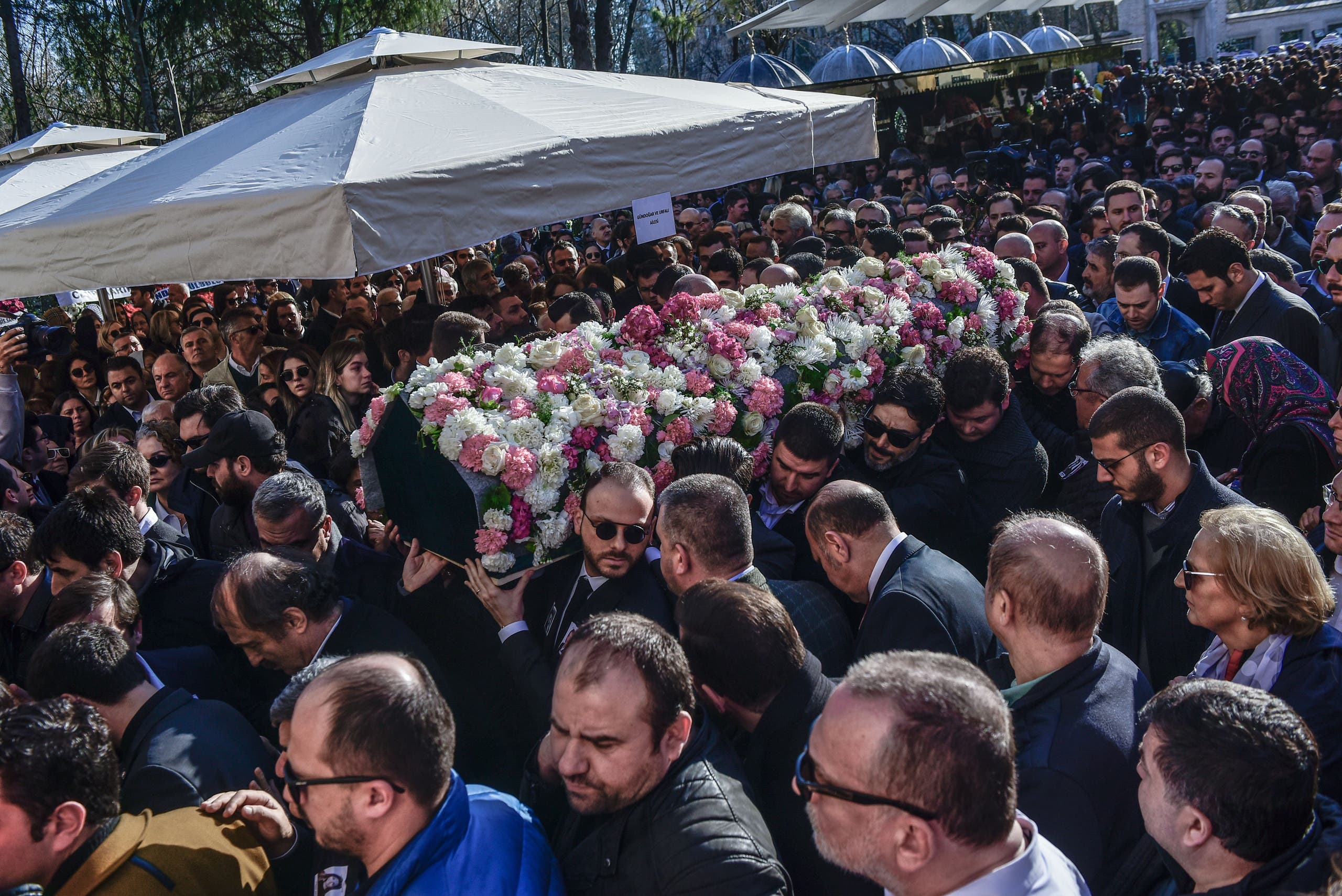 Relatives carry the coffin of Mina Basaran, one of the victims of a plane crash over Iran, during the funeral ceremony in Istanbul on March 15, 2018. Grieving families bade farewell to the young women killed in a plane crash over Iran while returning from a pre-wedding celebration for a Turkish businessman's daughter, in a tragedy that shocked the country.