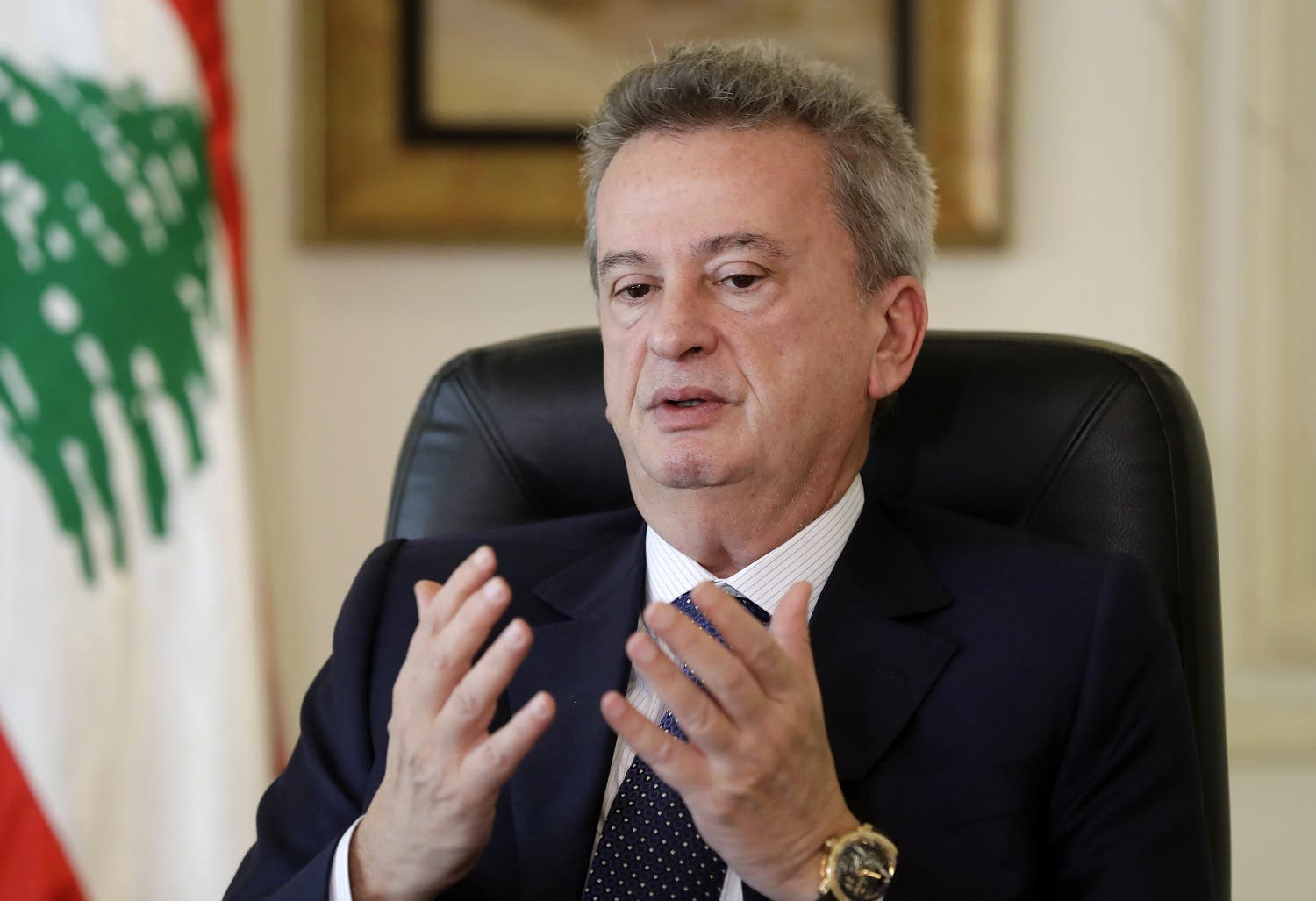 Lebanon's Central Bank Governor Riad Salameh speaks to a reporter at his office in Beirut on December 15, 2017. (AFP)