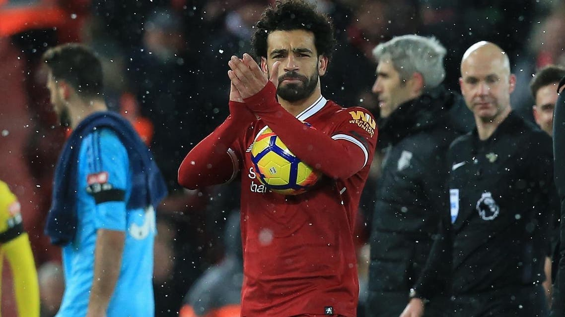 Liverpool's Egyptian midfielder Mohamed Salah gestures after the English Premier League football match against Watford at Anfield in Liverpool, north west England, on March 17, 2018. (AFP)