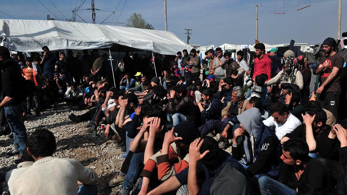 File photo of migrants and refugees blocking railway tracks to protest in the makeshift camp at the Greek-Macedonian border, near the Greek village of Idomeni where thousands of them are stranded. (AFP)