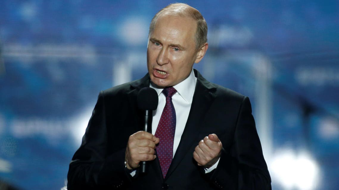 Russian president Vladimir Putin addresses the audience during a rally. (Reuters)