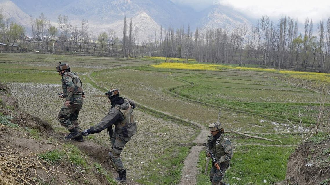 Indian soldiers take part in a search operation after a gunbattle between suspected militants and government forces in the Balhama area of Khanmoh district near Srinagar on March 16, 2018. (AFP)