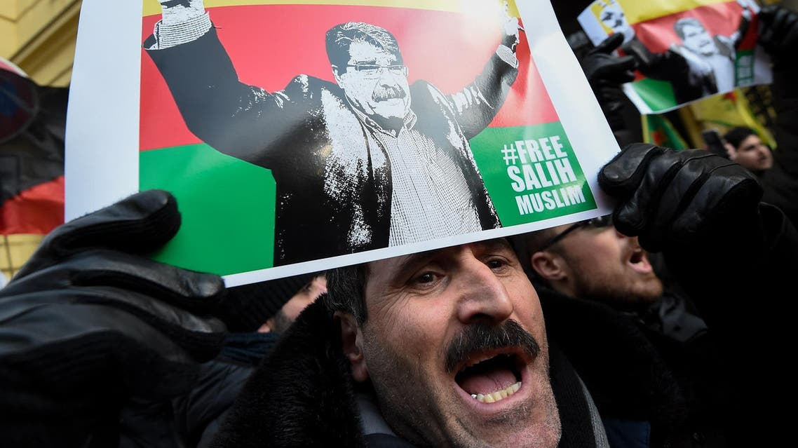 Supporters of Saleh Muslim celebrate his release in front of the municipal court in Prague on February 27, 2018. (AFP)
