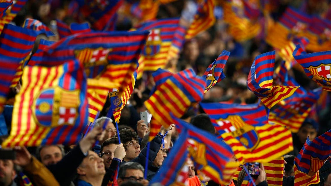 Barcelona supporters wave flags with the club colors during the Champions League match at the Camp Nou stadium in Barcelona on March 14, 2018. (AP)