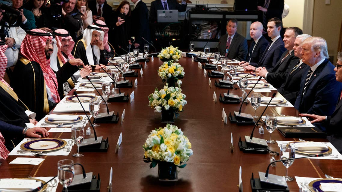 President Donald Trump listens as Saudi Crown Prince Mohammed bin Salman speaks during a working lunch in the Cabinet Room of the White House, Tuesday, March 20, 2018, in Washington. (AP Photo/Evan Vucci)