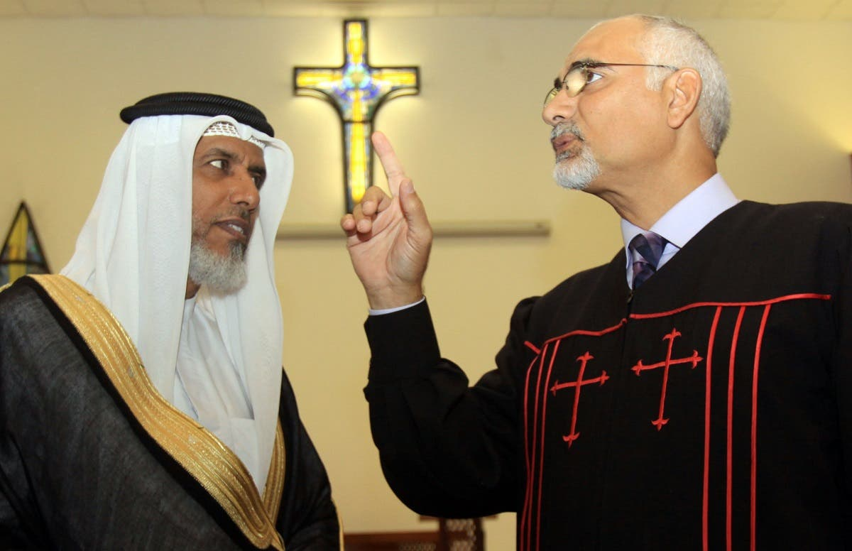 The Rev. Hani Aziz, right, speaks of the one God of Muslim and Christian beliefs, during a statement Thursday, Sept. 9, 2010, to journalists delivered with Muslim cleric Sheikh Salah bin Yousuf al-Jowder, left, at the National Evangelical Church in Manama, Bahrain. (AP)