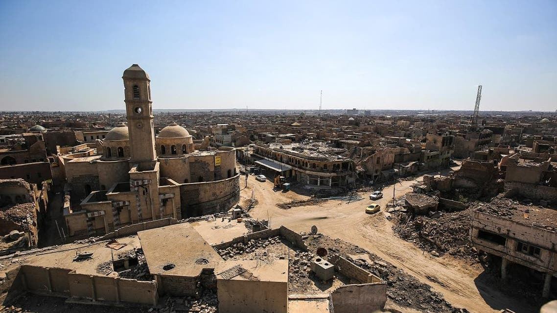 A picture taken on March 14, 2018 shows a view of destruction surrounding the Roman Catholic Church of Our Lady of the Hour (L) in the old city of Mosul, eight months after it was retaken by Iraqi government forces from the control of ISIS. (AFP).