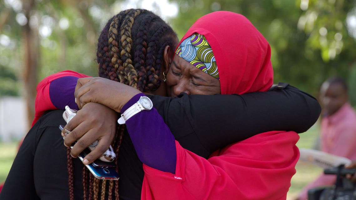 Members of the #BringBackOurGirls (#BBOG) campaign embrace each other at a sit-out in Abuja, Nigeria May 18, 2016. A Nigerian teenager kidnapped by Boko Haram more than two years ago has been rescued, the first of more than 200 girls seized in a raid on their school in Chibok town to return from captivity in the insurgents' forest lair, officials said on Wednesday. REUTERS/Afolabi Sotunde TPX IMAGES OF THE DAY
