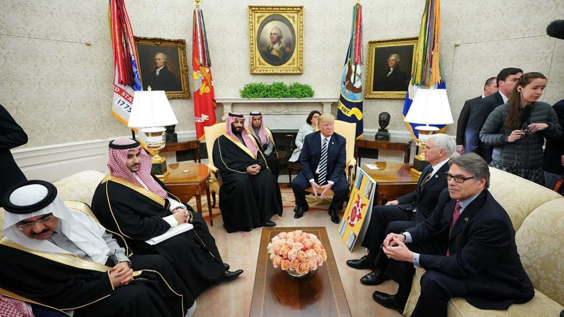 US President Donald Trump meets with Saudi Arabia's Crown Prince Mohammed bin Salman in the Oval Office of the White House on March 20, 2018 in Washington, DC. (AFP)