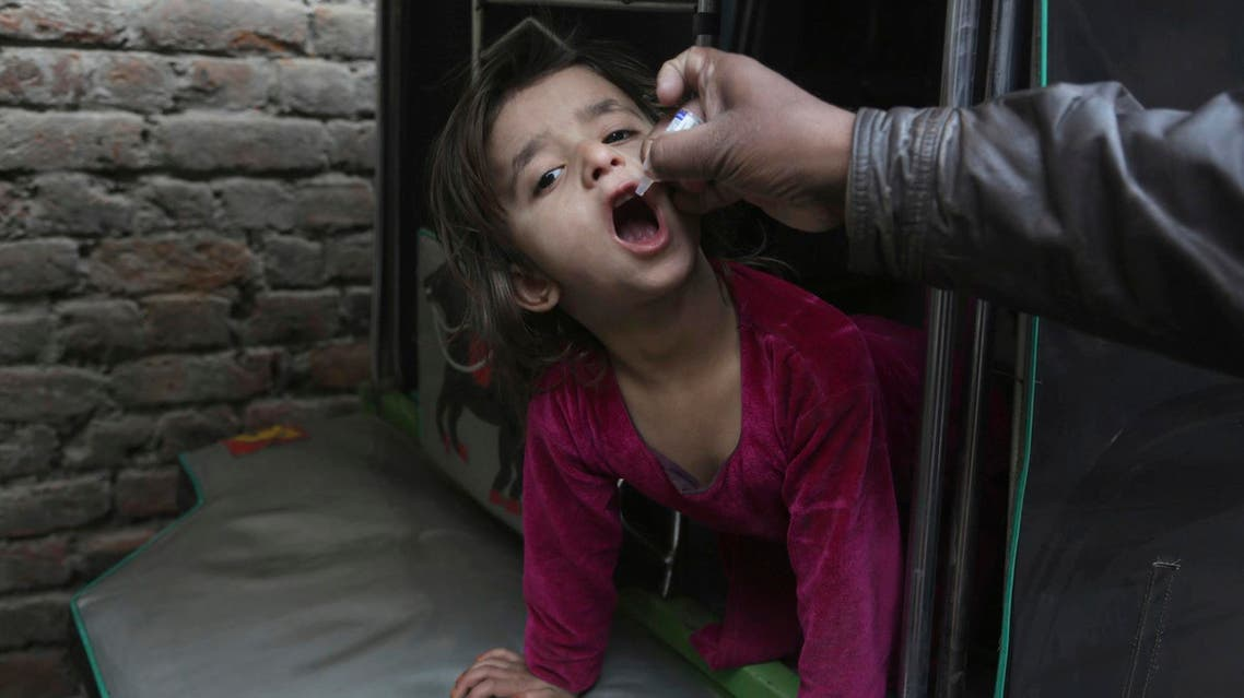 A health worker gives a polio vaccine to a child in Lahore, Pakistan, on Jan. 16, 2018. (AP)