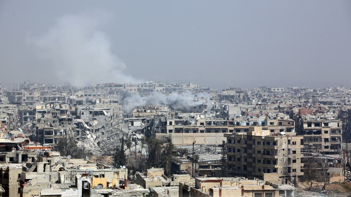 Smoke billows following Syrian government bombardment on the rebel-held besieged town of Harasta, in the Eastern Ghouta region on the outskirts of Damascus on March 12, 2018. Syrian regime forces cut off the largest town in Eastern Ghouta from the rest of the opposition enclave in a blow to beleaguered rebels defending their last bastion near Damascus. Government troops and allied militia have recaptured half of the besieged region in a blistering assault launched on February 18 that has left nearly 1,000 civilians dead and prompted global outcry. AFP