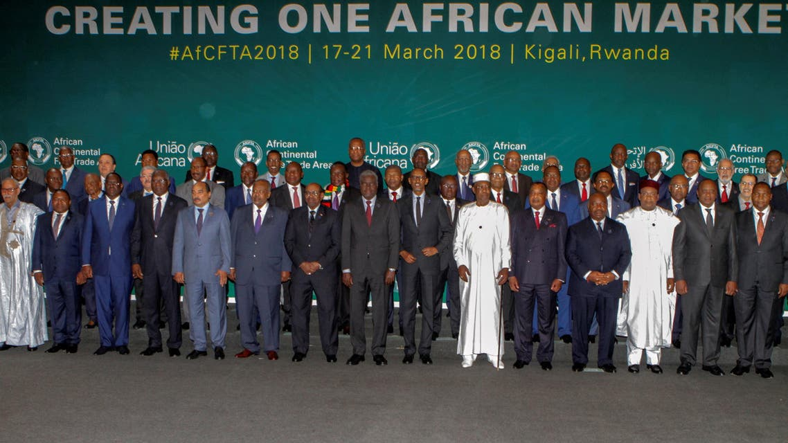 African leaders pose for a group photograph as they meet to sign a free trade deal that would create a liberalized market for goods and services across the continent, in Kigali, Rwanda March 21, 2018. REUTERS/Jean Bizimana NO RESALES. NO ARCHIVES.