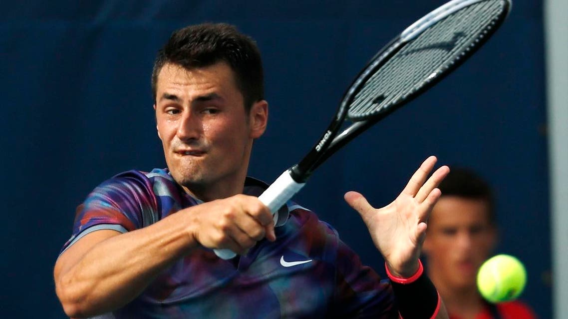 Bernard Tomic, of Australia, returns a shot from Gilles Muller, of Luxembourg, during the first round of the U.S. Open. (AP)
