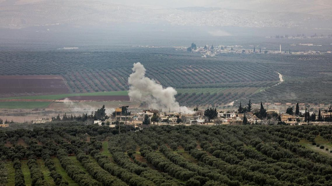 A picture taken on February 10, 2018 from the Syrian village of Atme in the northwestern province of Idlib shows smoke plumes rising in the village of Deir Ballut in the Afrin region. (AFP)