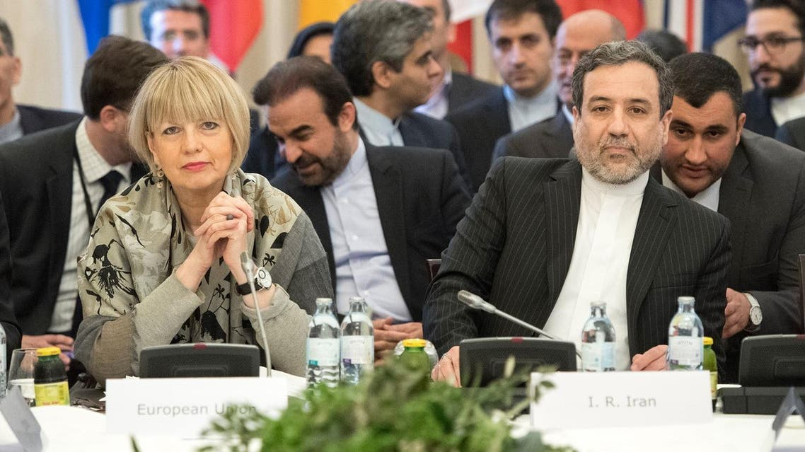 Abbas Araghchi (R), political deputy at the Ministry of Foreign Affairs of Iran, and the Secretary General of the European Union External Action Service (EEAS) Helga Schmid attend E3/EU+3 and Iran talks at Palais Coburg in Vienna, Austria on March 16, 2018. (AFP)