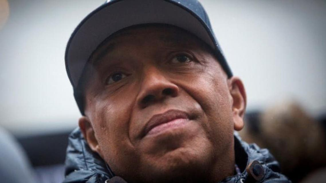 FILE PHOTO: Rap mogul Russell Simmons speaks at a news conference along with members of Justice League NYC to present a list of demands at City Hall in New York, U.S. December 10, 2014. REUTERS/Andrew Kelly/File Photo