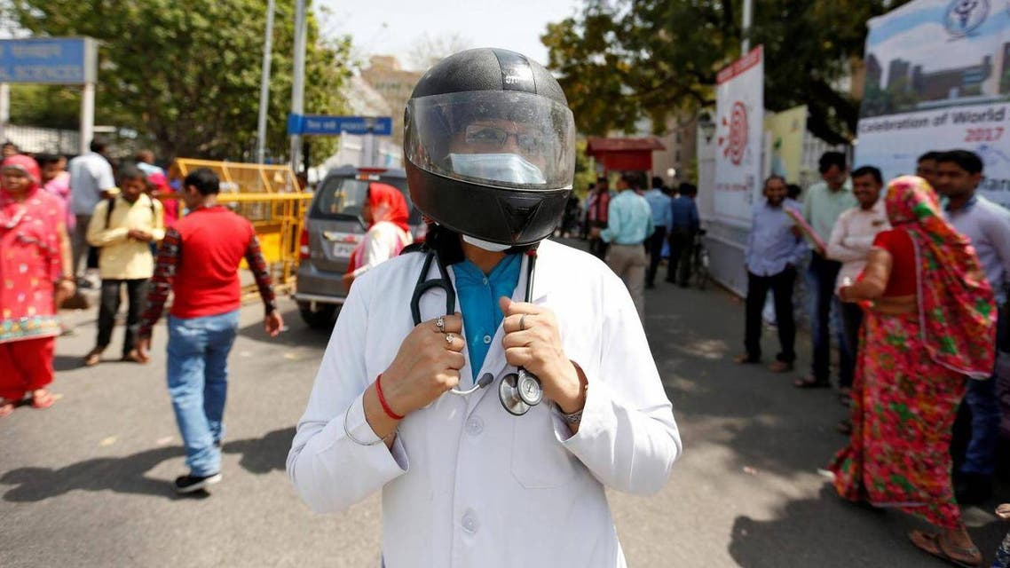 A doctor protests the lack of security offered to medical professionals on 23 March outside the All India Institute Of Medical Sciences (AIIMS) in New Delhi, India Reuters