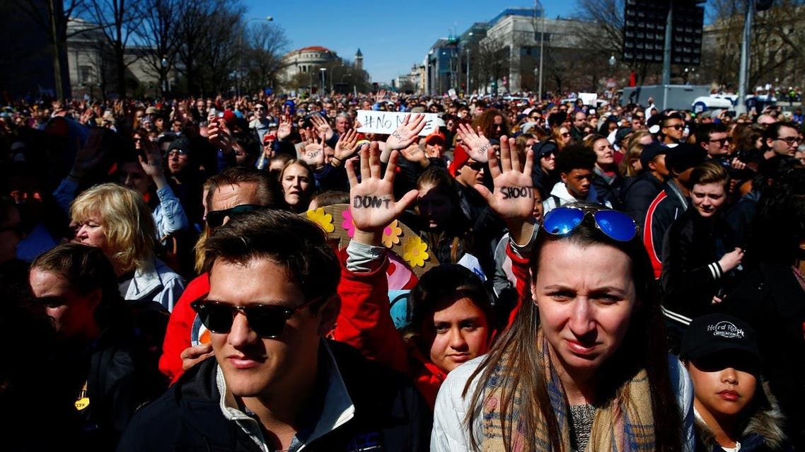 "Attendees are seen as students and gun control advocates hold the ""March for Our Lives"" event demanding gun control after recent school shootings at a rally in Washington, on March 24, 2018. (Reuters)"