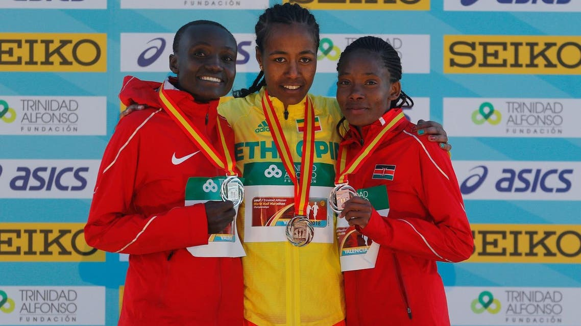 Ethiopia's Netsanet Gudeta Kebede poses with the gold medal and Kenya's Joyciline Jepkosgei and Kenya's Pauline Kaveke Kamulu pose with their silver and bronze medals. (Reuters)