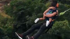 Father bungee jumps off 200ft bridge with toddler in Malaysia, sparks anger