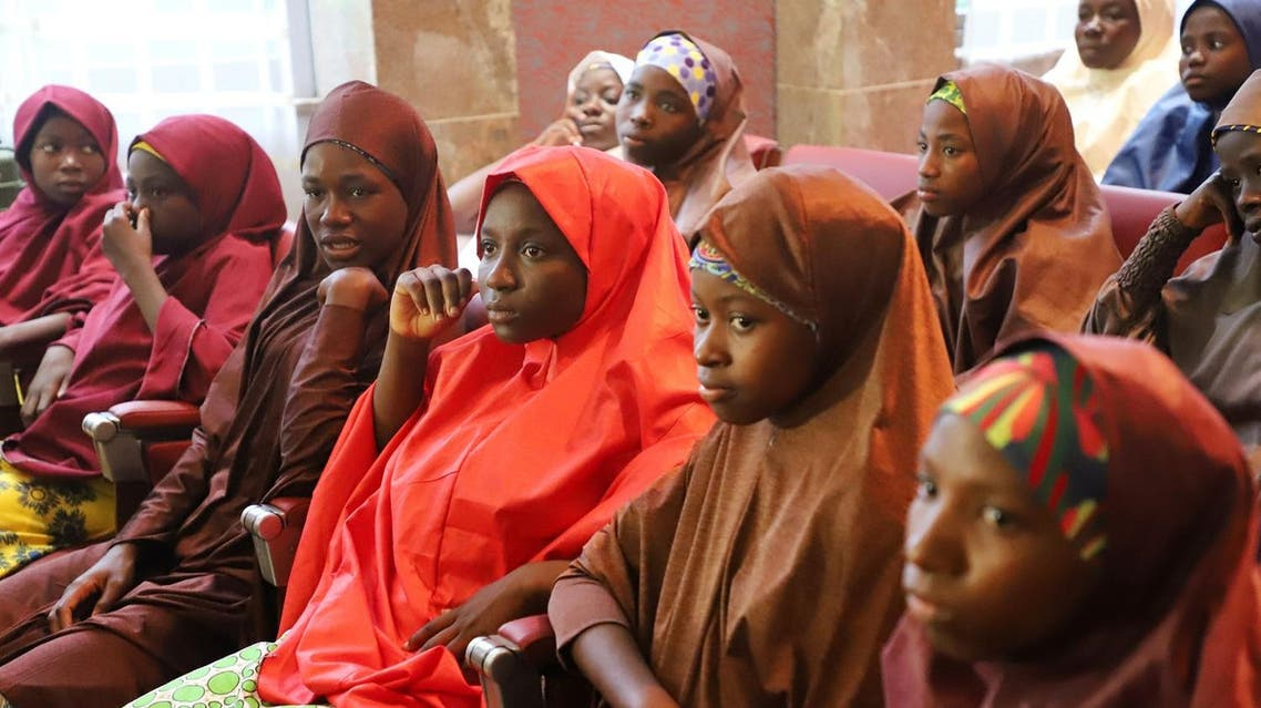 Released Nigerian school girls who were kidnapped by Boko Haram from their school in Dapchi, sit at the Presidential Villa in Abuja before meeting with the president on March 23, 2018. (AFP)