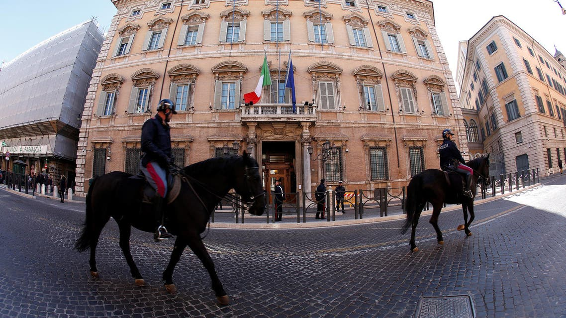 Italian police officers ride horses in front of the Senate prior the opening of the second session day since the March 4 national election in Rome, Italy March 24, 2018. REUTERS/Remo Casilli