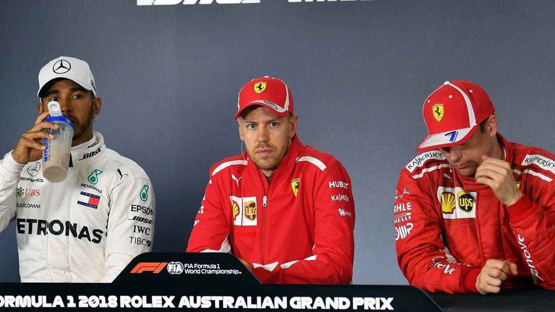 Ferrari's German driver Sebastian Vettel (C), second-placed Mercedes' British driver Lewis Hamilton (L) and third-placed Ferrari's Finnish driver Kimi Raikkonen (R) attend a press conference after the Formula One Australian Grand Prix in Melbourne on March 25, 2018. (AFP)