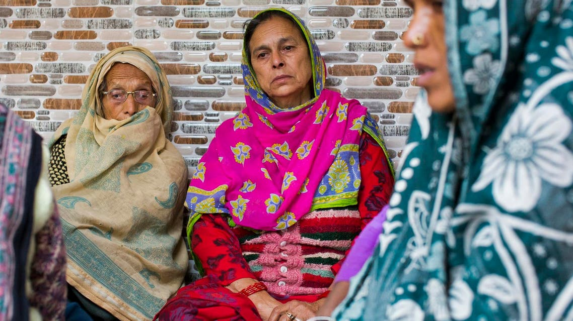 Tara Devi, left, mourns the death of her grandson Aman Kumar at her home in Dharmsala on March 21, 2018. (AP)