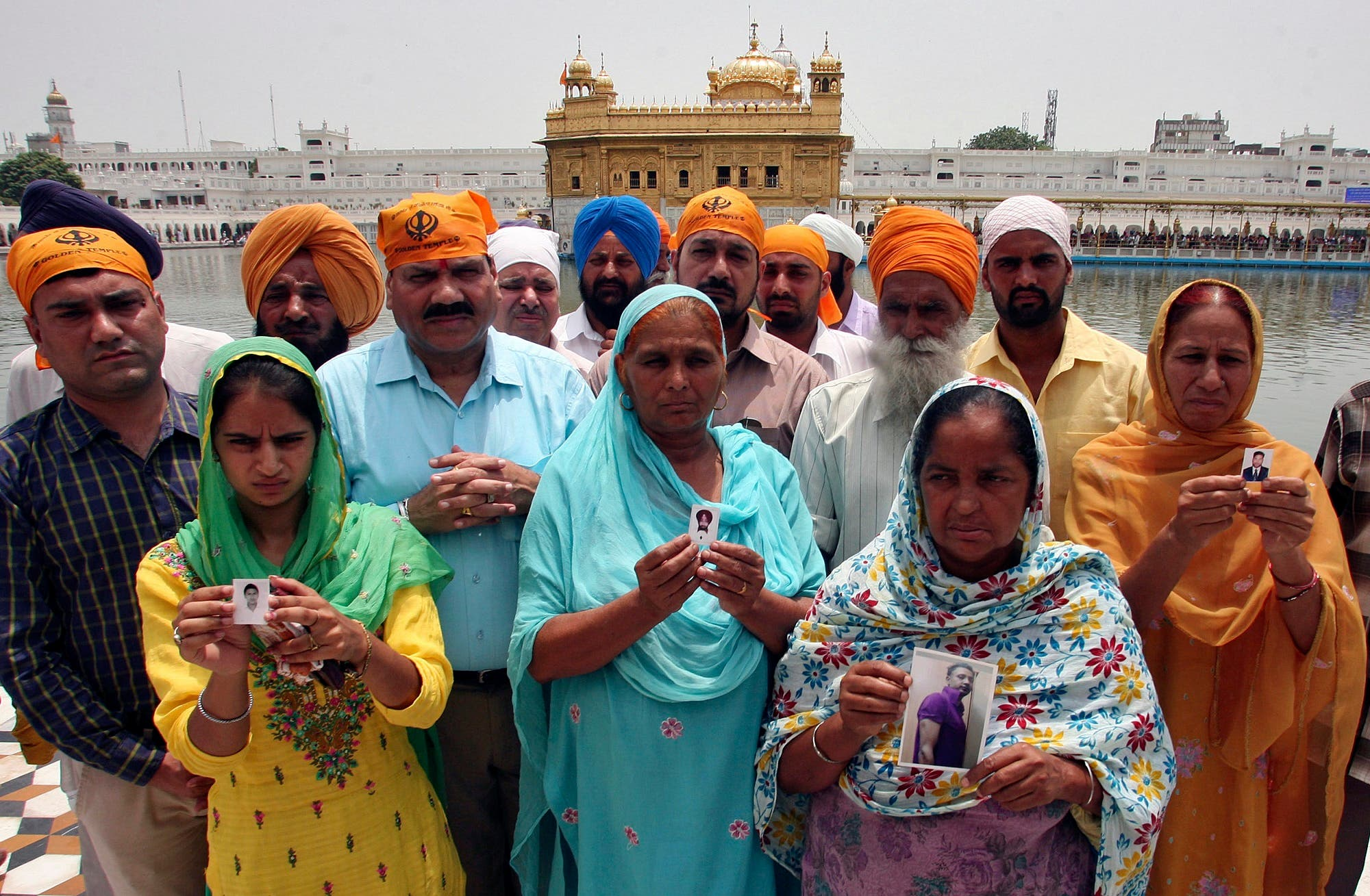 Relatives pose with the photographs of Indian workers kidnapped in Iraq in Amritsar on June 19, 2014. (Reuters)