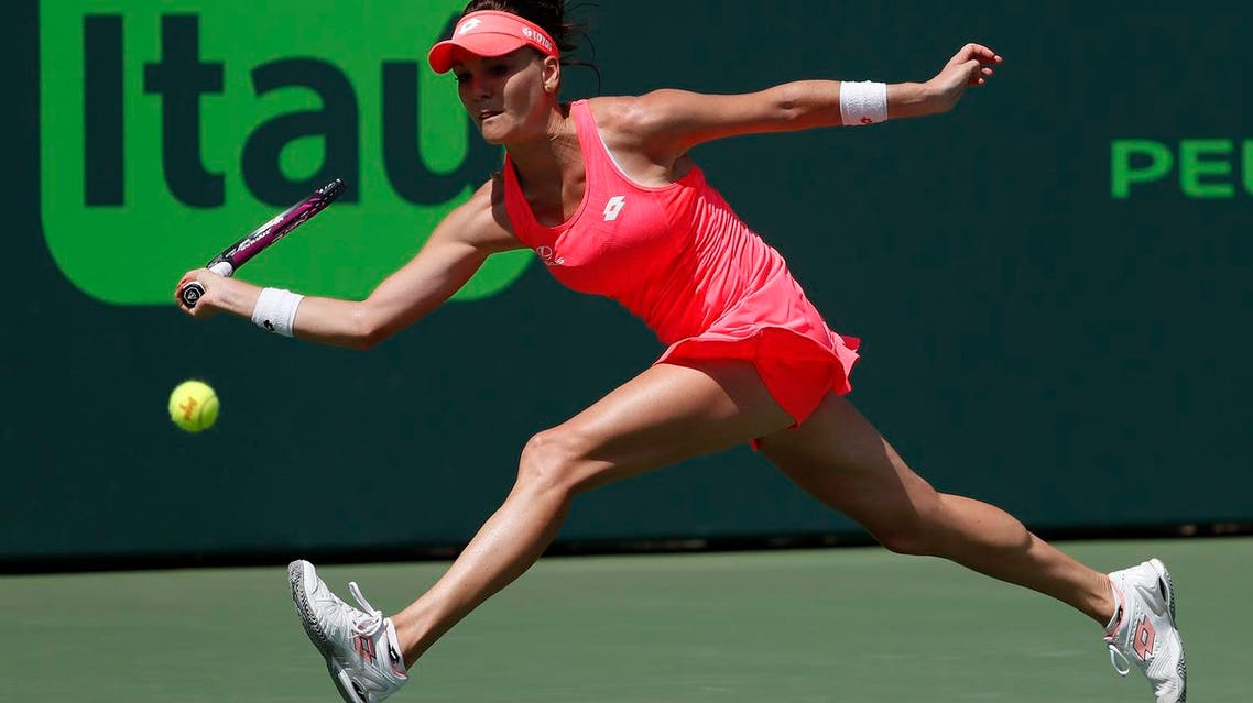 Agnieszka Radwanska of Poland reaches for a forehand against Simona Halep of Romania (not pictured) on day five of the Miami Open. (Reuters)