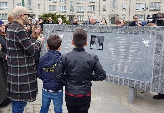 Mohamed el Bachiri and his sons in front of the stele inaugurated in Molenbeek on Wednesday 21 March 2018 in tribute to Loubna Lafquiri (Supplied)