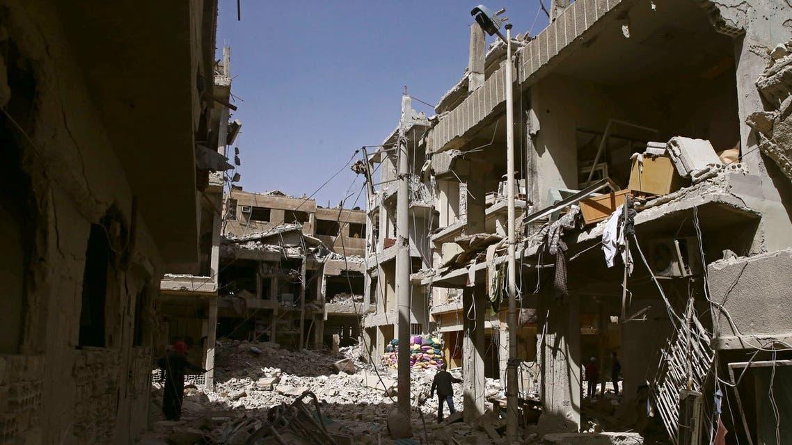 جانب من الدمار في دوما بالغوطة الشرقية يوم 21 مارس