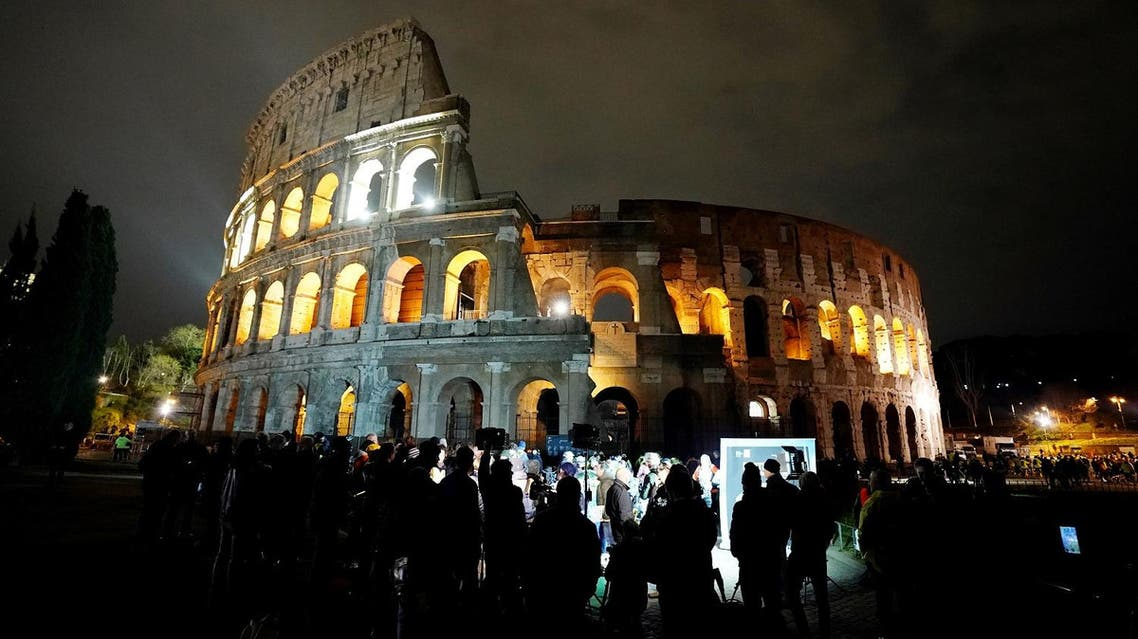A picture taken on March 24, 2018 shows the ancient Colosseum normal lighted during the Earth Hour initiative in Rome. (AFP)
