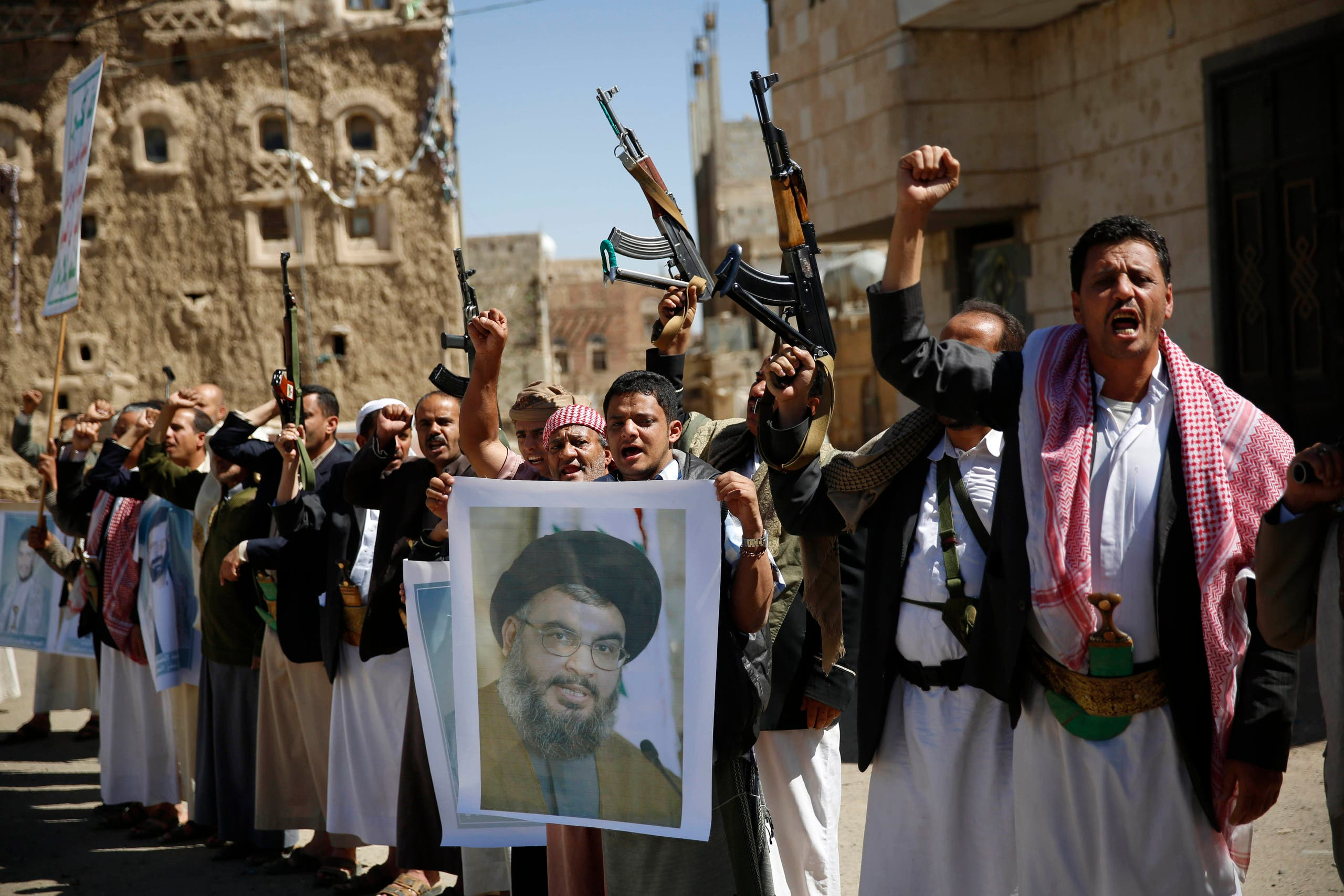 Houthis hold a poster of Hassan Nasrallah to show their support to Hezbollah in Sanaa on March 3, 2016. (AP)