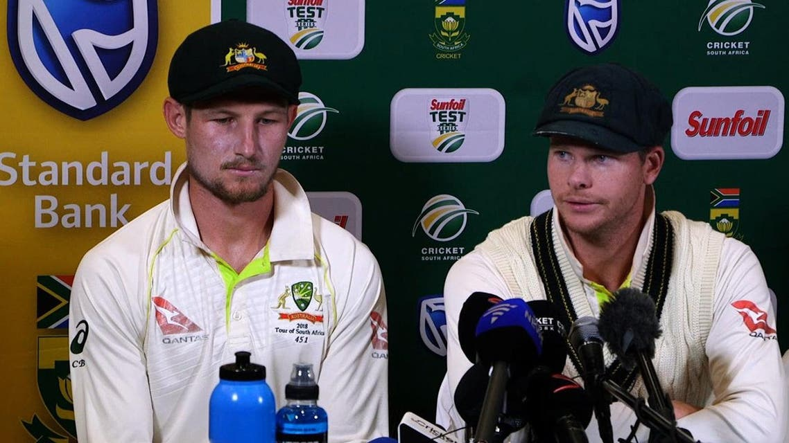 This video grab taken from a footage released by AFP TV shows Australia's captain Steve Smith (R), flanked by teammate Cameron Bancroft, speaking during a press conference in Cape Town, on March 24, 2018 as he admitted to ball-tampering during the third Test against South Africa. (AFP)