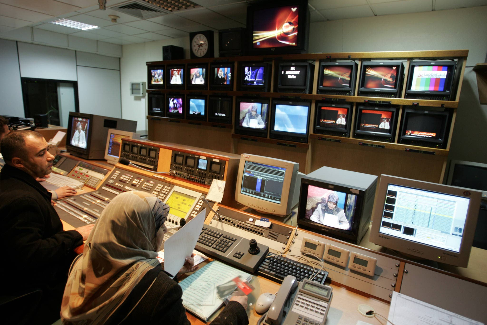 Journalists work 07 December 2004 at the Al-Manar television station, the mouthpiece of the Lebanese Shiite Muslim fundamentalist Hezbollah. (AFP)
