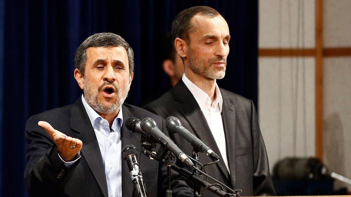 Former Iranian president Mahmoud Ahmadinejad (L) speaks, as he is accompanied by former Iranian Vice President Hamid Baghaei. (File photo: AFP)