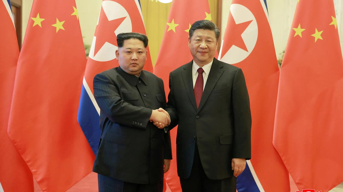North Korean leader Kim Jong Un shakes hands with Chinese President Xi Jinping in Beijing, as he paid an unofficial visit to China, in this undated photo released by North Korea's Korean Central News Agency (KCNA) in Pyongyang March 28, 2018. KCNA/via Reuters ATTENTION EDITORS - THIS IMAGE WAS PROVIDED BY A THIRD PARTY. REUTERS IS UNABLE TO INDEPENDENTLY VERIFY THIS IMAGE. NO THIRD PARTY SALES. NOT FOR USE BY REUTERS THIRD PARTY DISTRIBUTORS. SOUTH KOREA OUT. NO COMMERCIAL OR EDITORIAL SALES IN SOUTH KOREA.