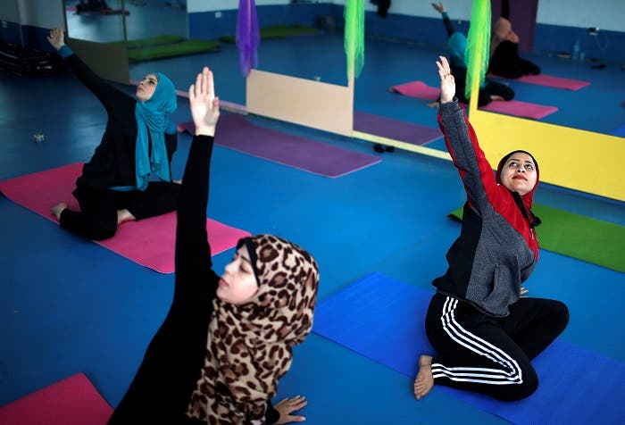 Palestinian women take part in a yoga session in Gaza City March 28, 2018. (Reuters)