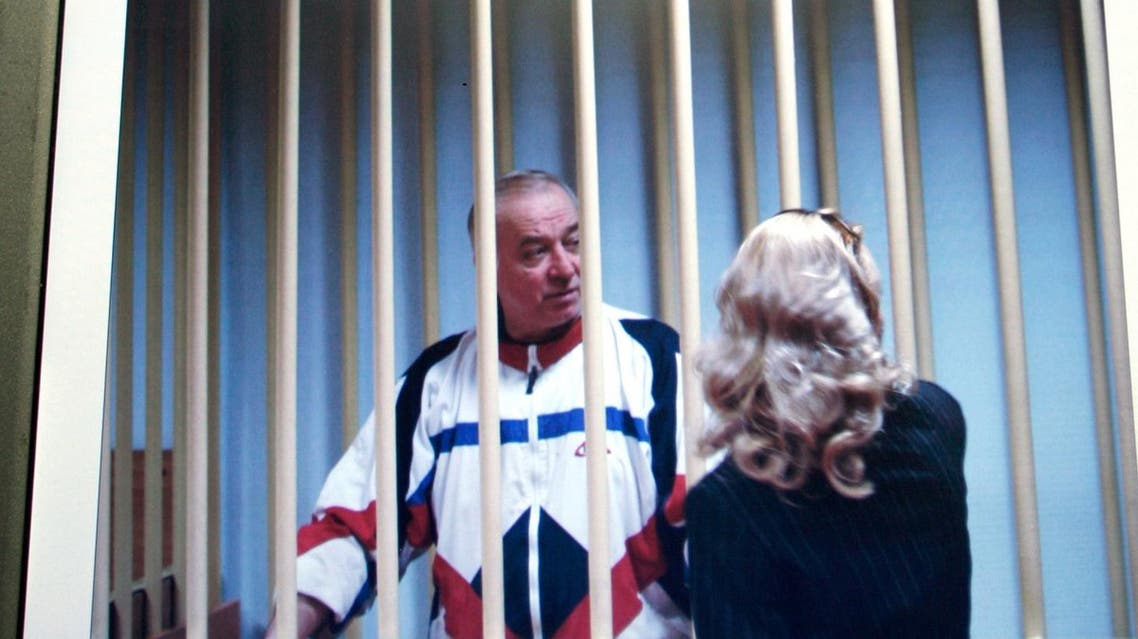 File picture of Sergei Skripal, a former Russian military intelligence officer,  as he speaks to his lawyer from behind bars seen on a screen of a monitor outside a courtroom in Moscow. (AP)