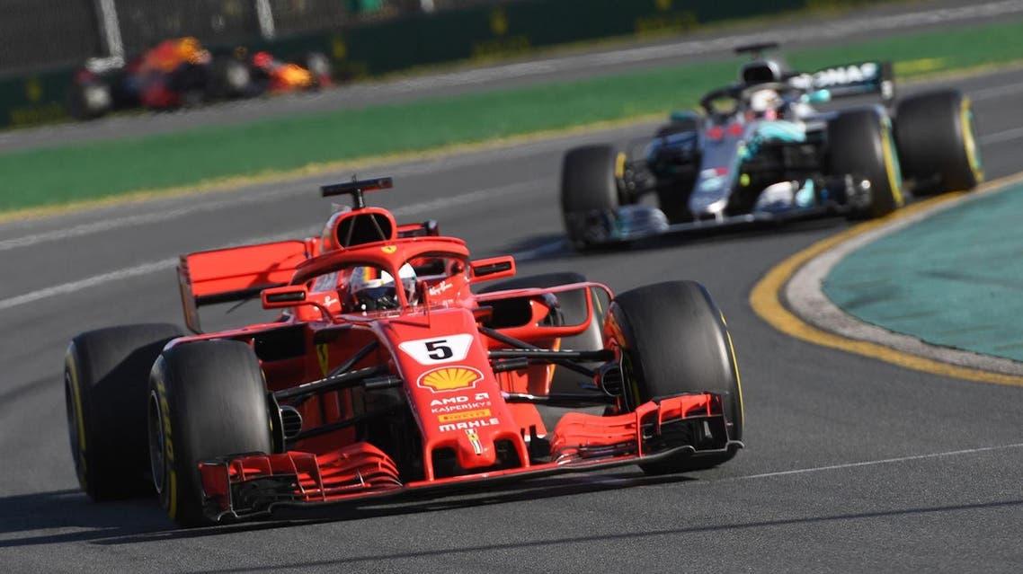Ferrari's German driver Sebastian Vettel (front) leads Mercedes' British driver Lewis Hamilton during the Formula One Australian Grand Prix in Melbourne on March 25, 2018. (AFP)