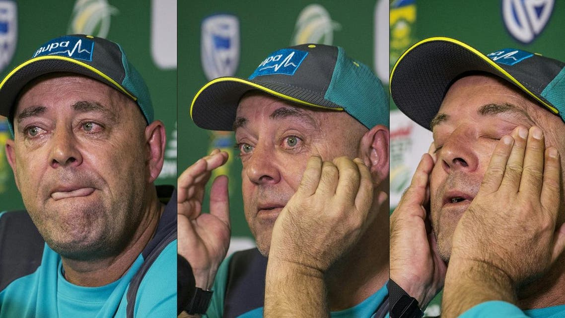 Head Coach of the Australia cricket team Darren Lehmann wiping his eyes and responding to questions during a press conference in Johannesburg on March 29, 2018 at which he announced his resignation after the forthcoming Test match against South Africa. (AFP)