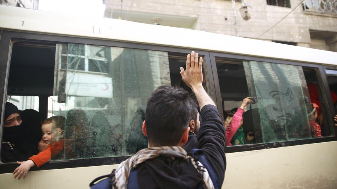 Douma eastern ghoura syria evacuating bus. (Reuters)